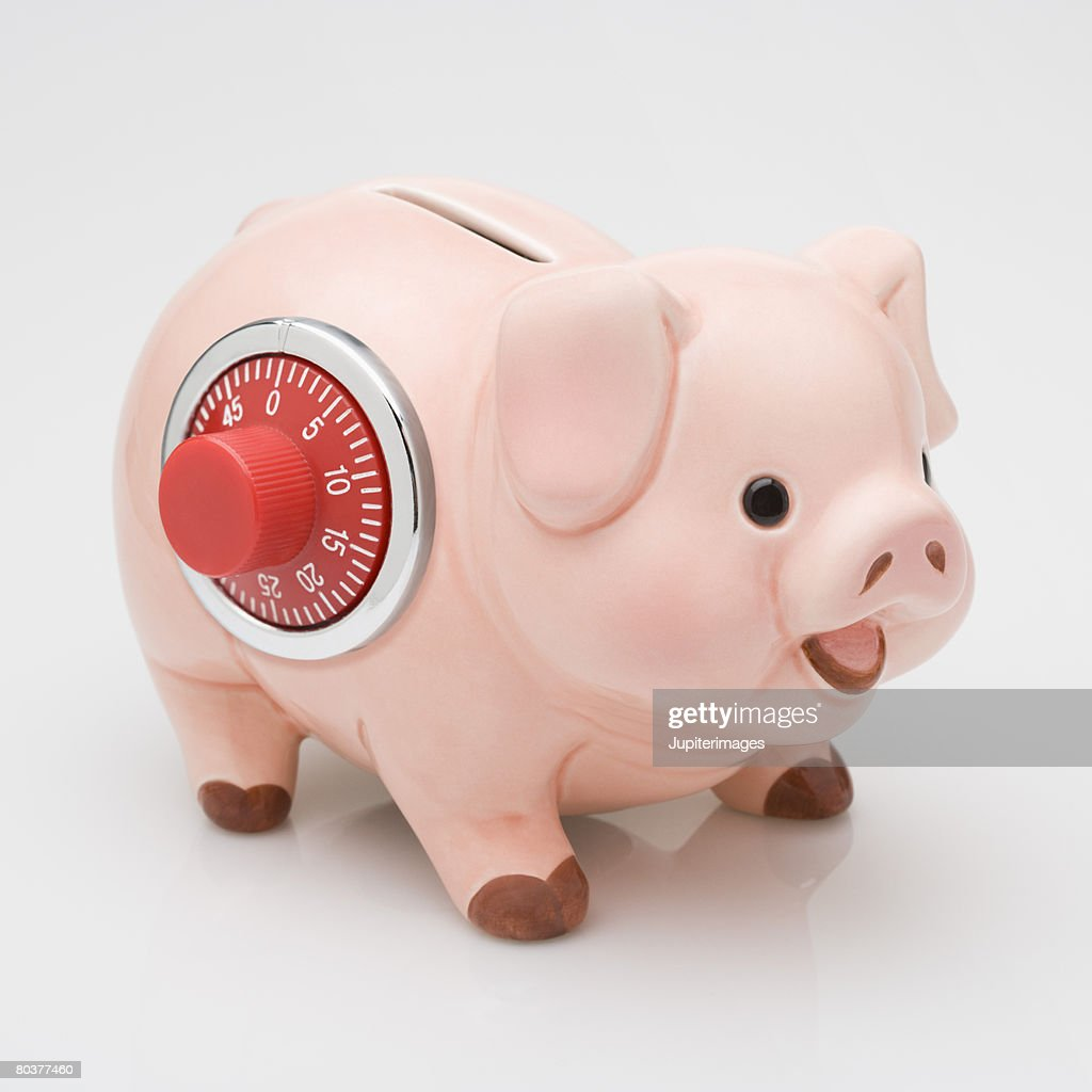 Piggy bank with combination lock stock photo getty images for Large piggy bank with lock