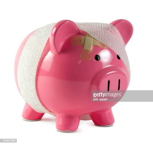 Piggy bank with gauze and band aids