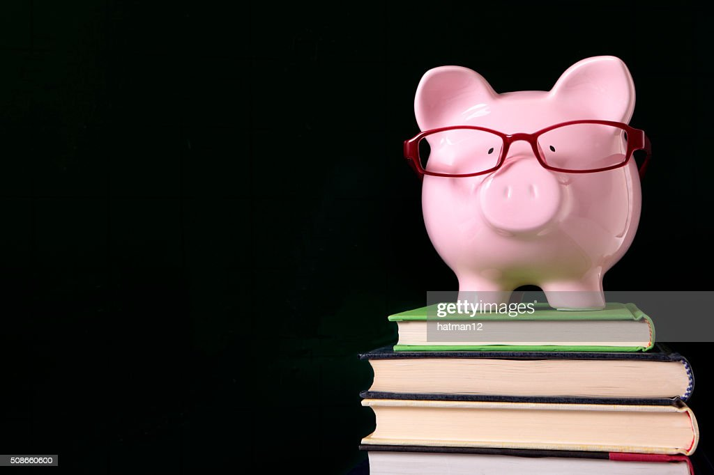 Piggy bank with glasses and blackboard : Stock Photo