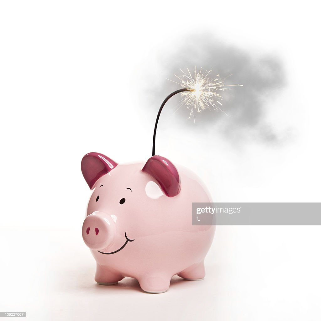 Piggy Bank with Lit Bomb Fuse, Isolated on White : Stock Photo