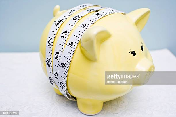 Piggy Bank with Measure Tape around it