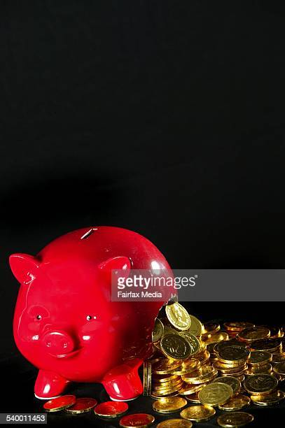 Piggy bank with money pouring out of it 10 November 2005 AFR Picture by LOUIE DOUVIS