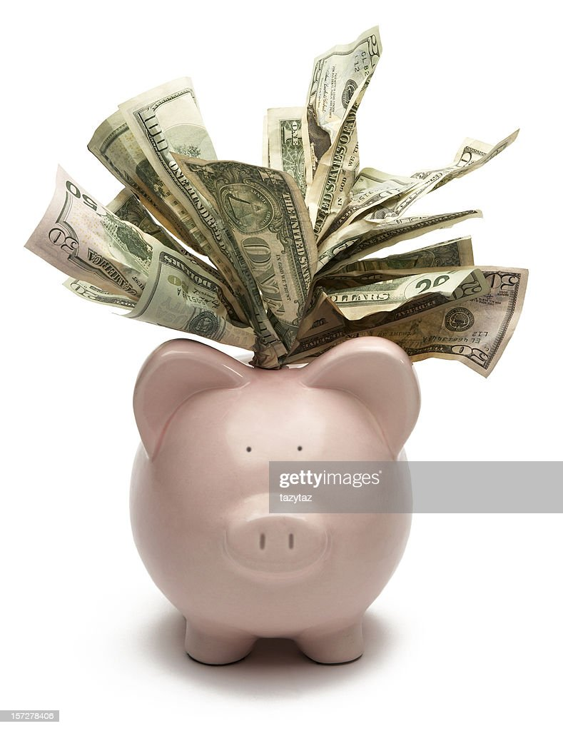 A piggy bank with notes spilling out of the top