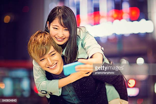 Piggyback Japanese couple