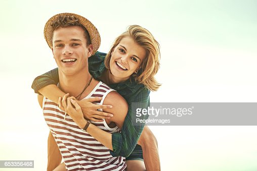 Piggybacks on the beach : Stock Photo