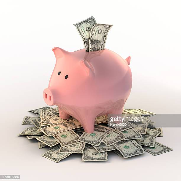 Piggybank full of dollar bills (Clipping path included)