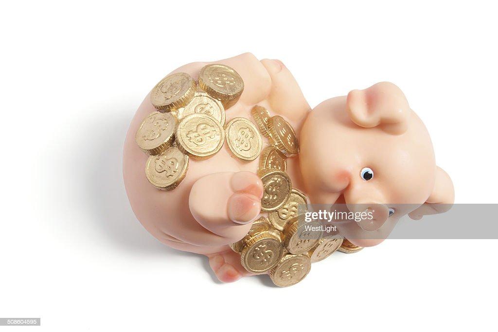 Piggybank com moedas : Foto de stock