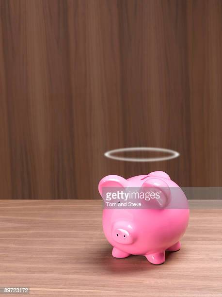Piggybank with halo in office.