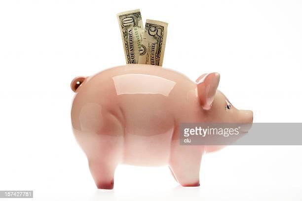 Sparschwein mit US-Dollar auf weißem Hintergrund, studio-Aufnahme