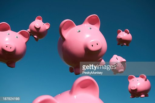 Pigs Fly In Sky Full Of Flying Pink Piggy Banks Stock