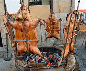 pigs roasted on a spit