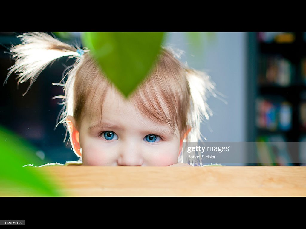 Pigtail Peek-a-boo : Stock Photo