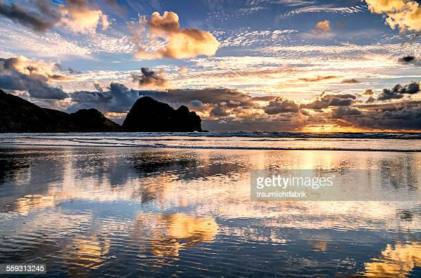 Piha beach ocean reflections