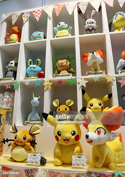 Pikachu characters from the video game 'Pokemon' sit on display Tomy Co' s booth at the International Tokyo Toy Show 2014 in Tokyo Japan June 12 2014...