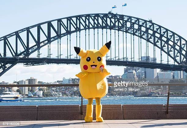 Pikachu doing some promotional meeting and greeting for a mobile phone company near to the Opera House and Harbour Bridge on July 23 2016 in Sydney...