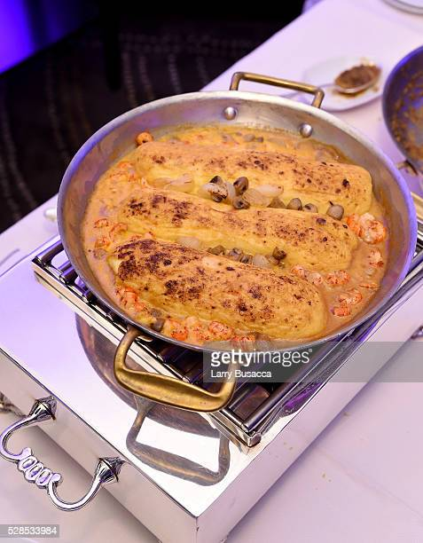 Pike Quenelles with Sauce Nantua and Crayfish is served to guests at Saveur and AirFrance Celebrate Saveur's France Issue at Daniel on May 5 2016 in...