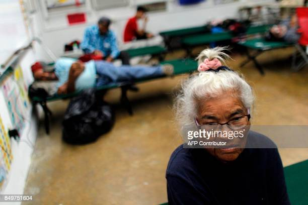 Pilar Gonzalez sits on a cot at a shelter as Hurricane Maria approaches Puerto Rico in Fajardo on September 19 2017 Maria headed towards the Virgin...