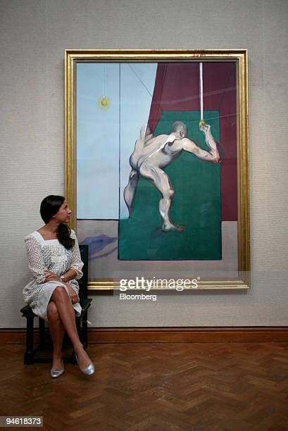 Pilar Ordovas director and head of postwar and contemporary art at Christie's poses with Francis Bacon's painting 'Study from the Human Body Man...
