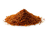 A pile of a red bbq spice mix ioslated on white.