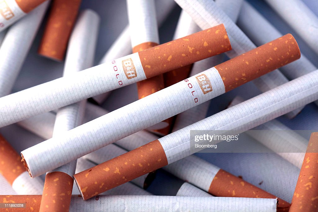 A pile of Benson & Hedges Gold cigarettes, produced by British American Tobacco Plc, sit arranged for a photograph in London, U.K., on Thursday, April 7, 2011. The global market for cigarettes excluding China, which is largely closed to foreign tobacco companies, will probably shrink by 2.5 percent in 2011, BAT Chief Executive Officer Nicandro Durante said Feb. 24. Photographer: Jason Alden/Bloomberg via Getty Images
