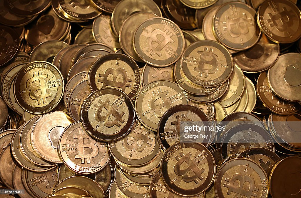 A pile of Bitcoin slugs sit in a box ready to be minted by Software engineer Mike Caldwell in his shop on April 26, 2013 in Sandy, Utah. Bitcoin is an experimental digital currency used over the Internet that is gaining in popularity worldwide.