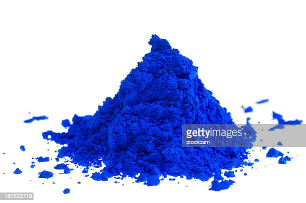 Pile of blue pigment powder on white