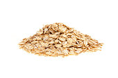 Heap of oat flakes - isolated on a white background