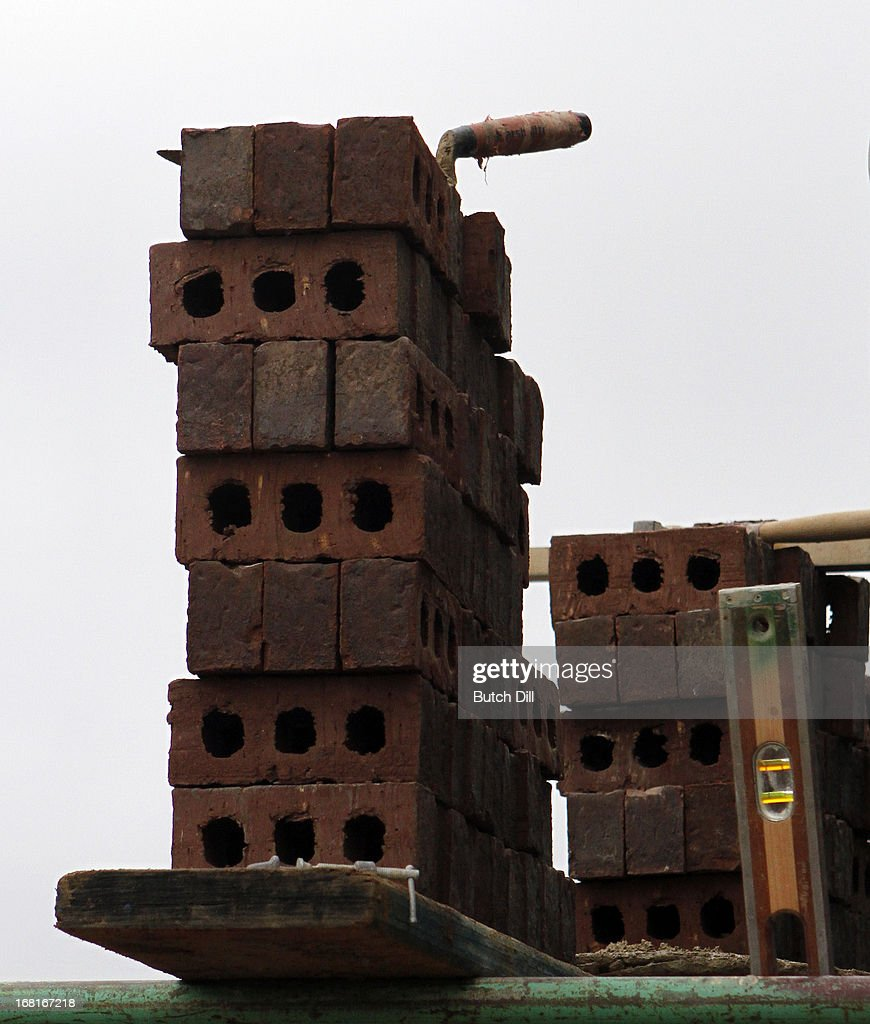 A pile of bricks sits on some scaffolding as actor <a gi-track='captionPersonalityLinkClicked' href=/galleries/search?phrase=Michael+O%27Neill+-+Actor&family=editorial&specificpeople=15096917 ng-click='$event.stopPropagation()'>Michael O'Neill</a> visits a Habitat For Humanity home on May 6, 2013 in Birmingham, Alabama.