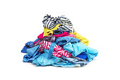 A pile of bright clothes isolated on white background