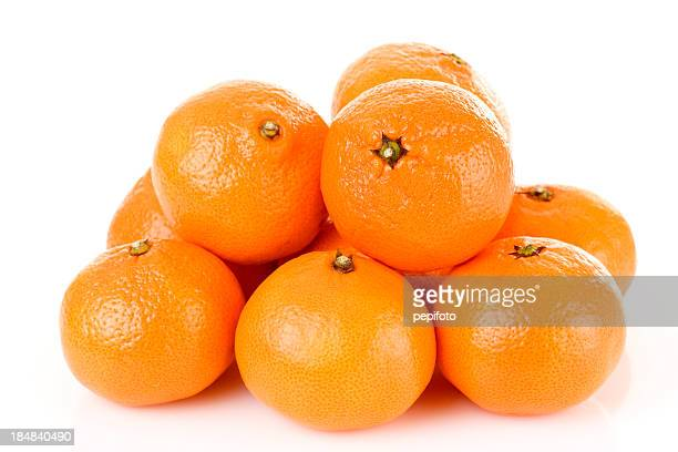 Pile of bright fresh tangerine fruits on a white background