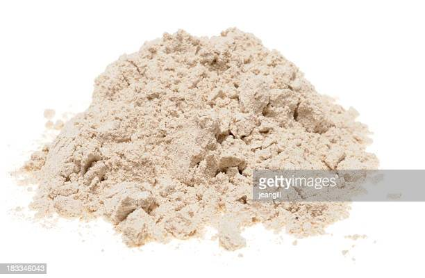 Pile of buckwheat flour on a white background
