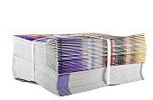 Pile of bundled magazines isolated on white background
