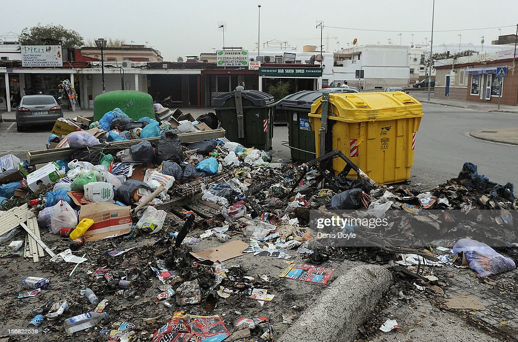 A pile of burnt uncollected garbage waits to be collected during the 21st day of the garbage collectors strike on November 22, 2012 in Jerez de la Frontera, Spain. The garbage collectors will vote today on a compromise deal which saves the 123 jobs due to be cut in favour of reductions in salaries.