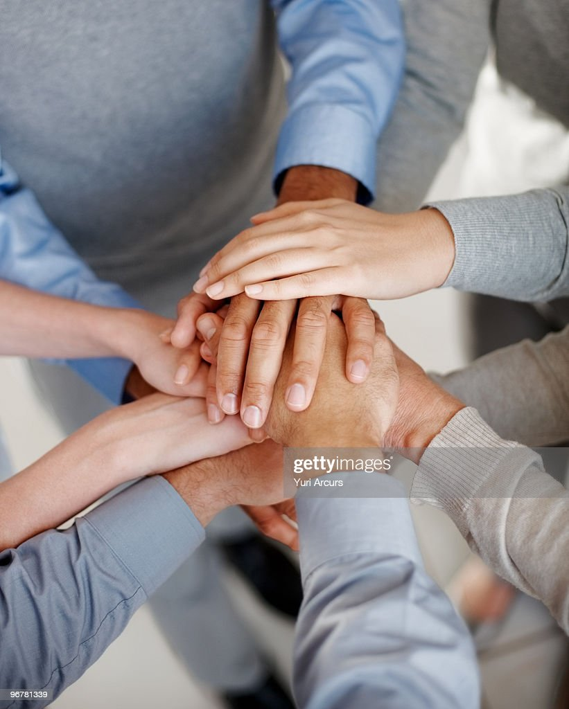 Pile of business peoples hands together : Stock Photo