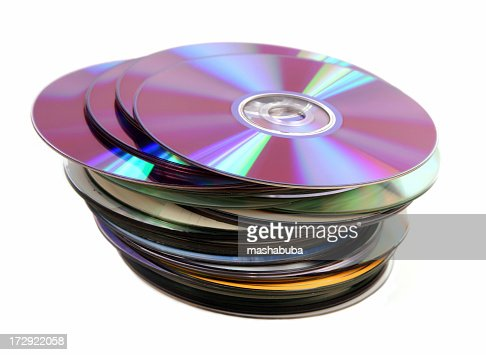 Pile of Cd DVD Discs on a white background