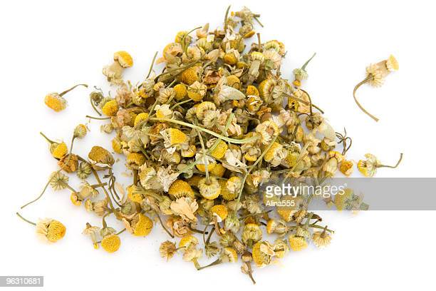 Pile of chamomile on white