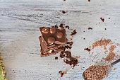 closeup still life food photography/ Closeup of chocolate whit hazelnuts