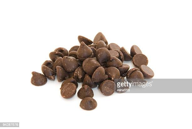 Pile of chocolate chips on white
