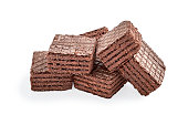 pile of chocolate square brownie wafer biscuits isolated on white backdrop. closeup view