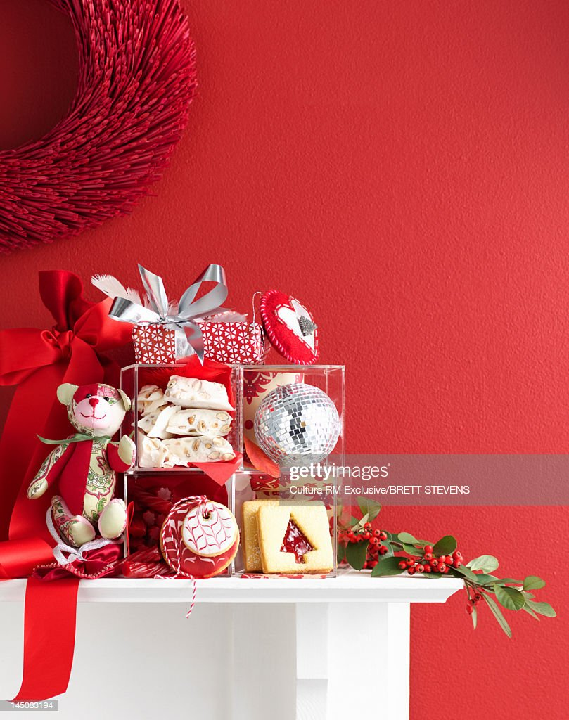 Pile of Christmas decorations on mantle : Stock Photo