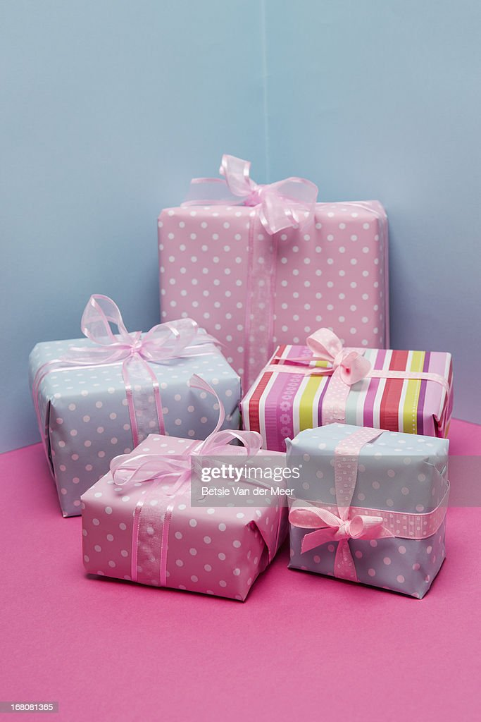 Pile of colorful presents with pink ribbons. : Stock Photo