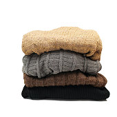 Pile of colorful warm clothes on a white background
