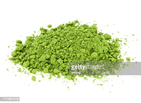 Pile of crumbled green Matcha tea on white background