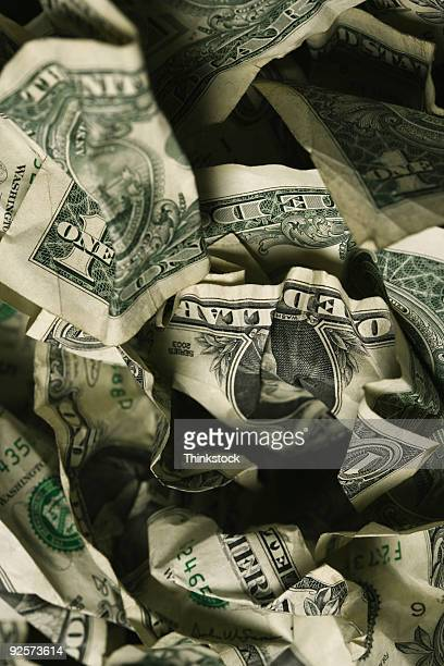 Pile of crumpled dollar bills