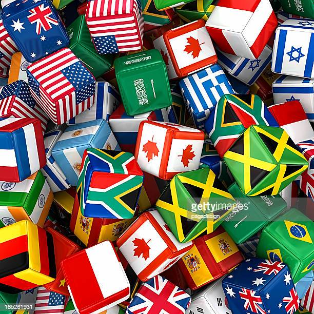 Pile of cubes covered with international flags