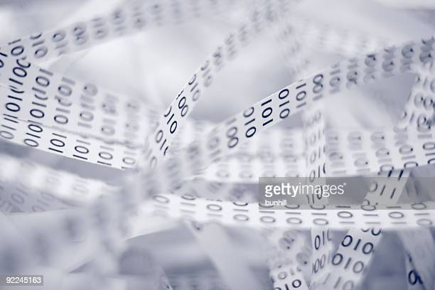 A pile of data strips with numbers in them