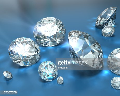A pile of diamonds of various sizes on a blue background