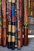 Close up view of a pile of didgeridoo musical instruments.