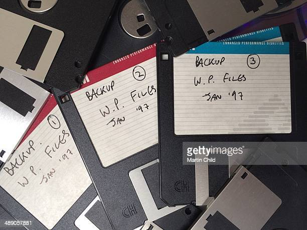 Pile of discarded old floppy discs used for backup