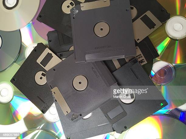 Pile of discarded old zip discs floppy discs and CD Rom's